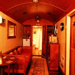 This romantic getaway is ideal for the railway enthusiasts who will appreciate the attention to detail here to turn an 80 year old carriage into stunning romantic accommodation. Carefully restored and luxuriously fitted out with your comfort in mind. A private outdoor wash house is available so grab that bottle of bubbles, relax and enjoy the view. The beach is a 2 minute walk away and with the stunning backdrop that is on your doorstep what more could you ask for.